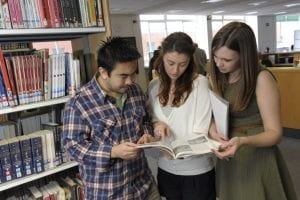 Students researching for group project using the UCB libary facilities.